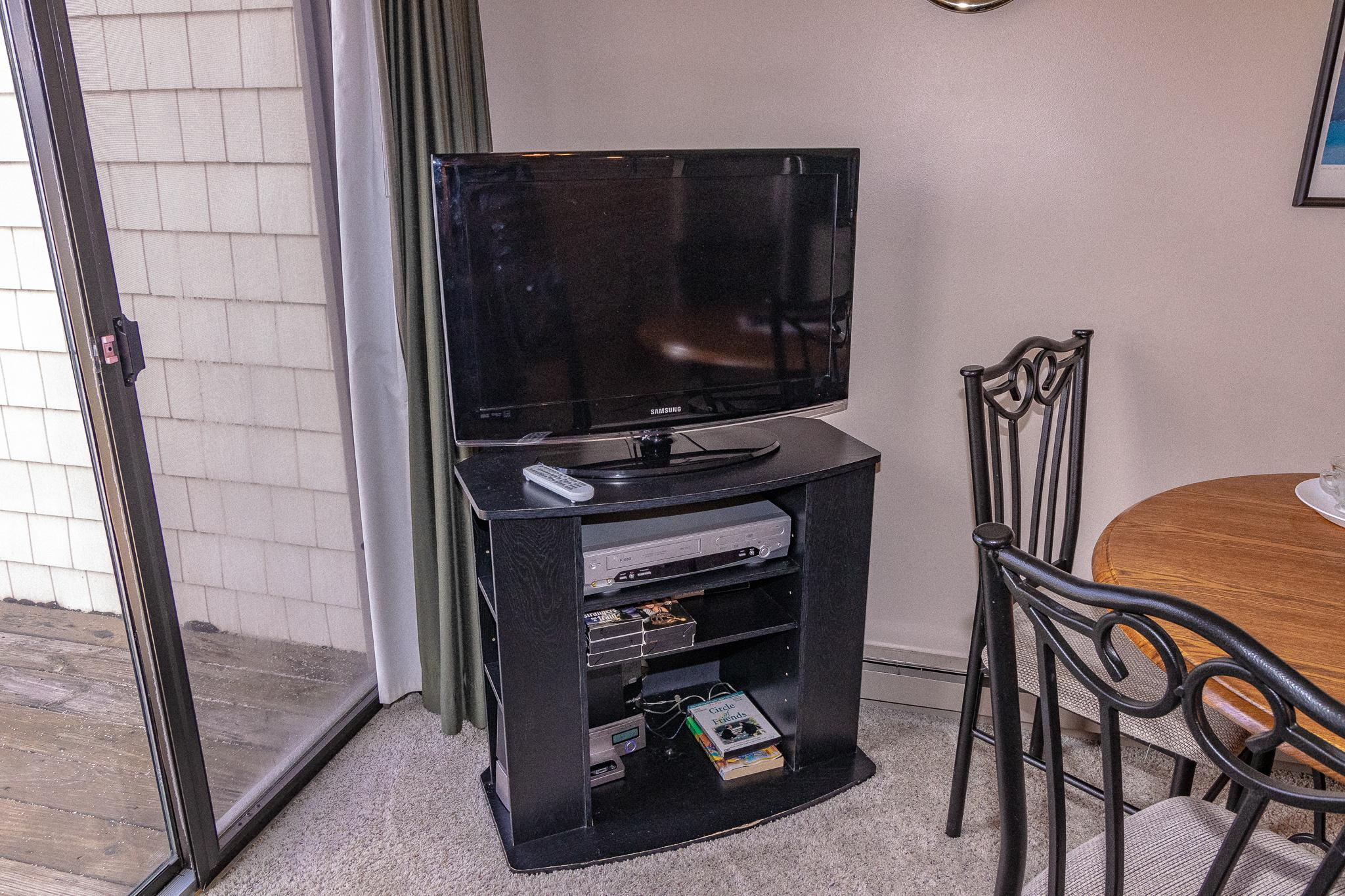 Flat-screen TV with DISHTv, HD channels, HBO and and DVD player.