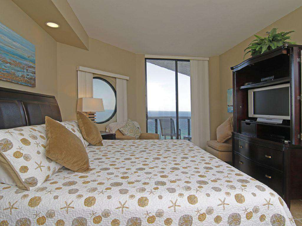 The master bedroom has a king sized bed, balcony access with an awesome view, an en suite bathroom, and a large walk-in closet.