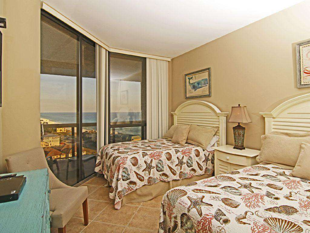 The second bedroom has balcony access and 2 queen sized beds.