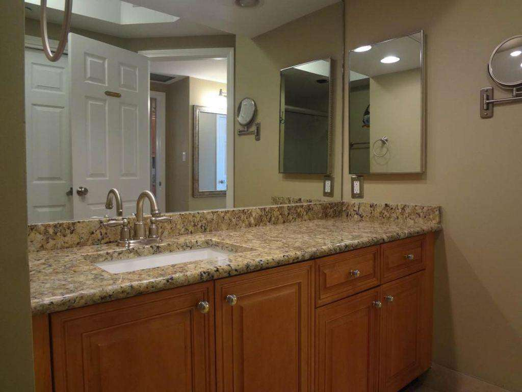 The master bathroom features granite counter tops.