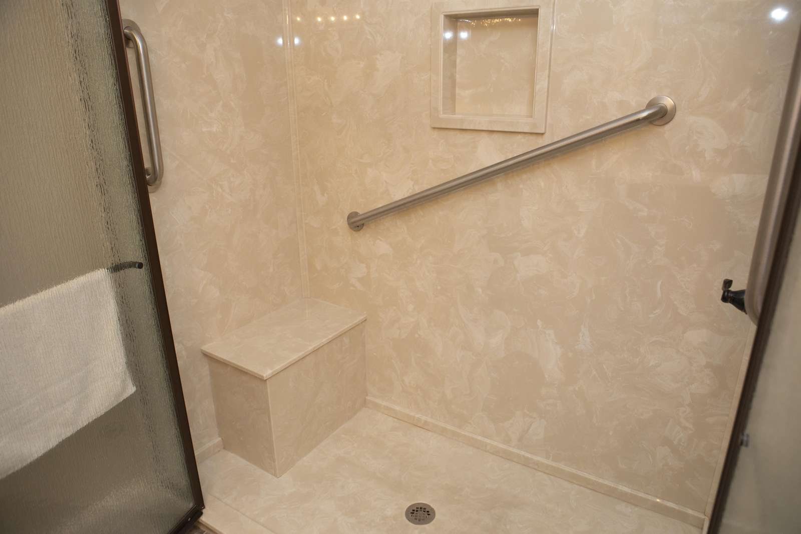 You will love the French Door, marble walk-in shower with seat and handrails!
