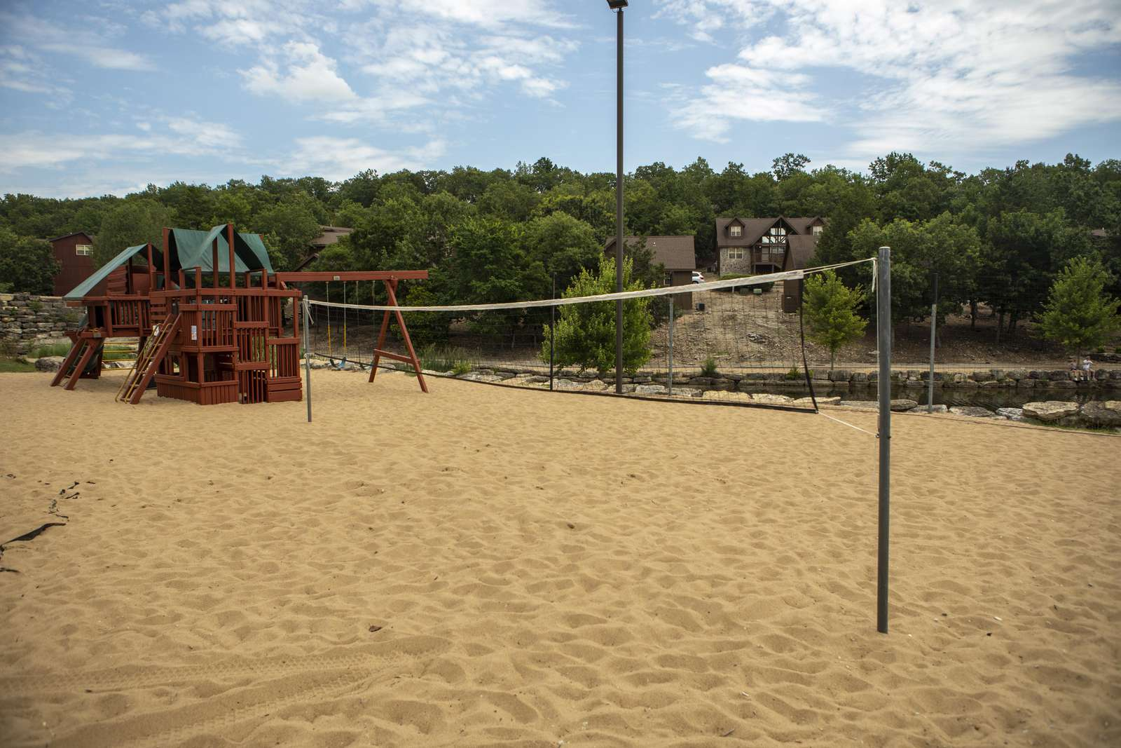 Sand volleyball and playground at Fox Hollow in Stonebridge.