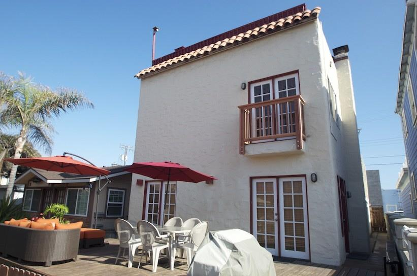 Front of House with Barbecue, Table and Chairs and Patio Furniture