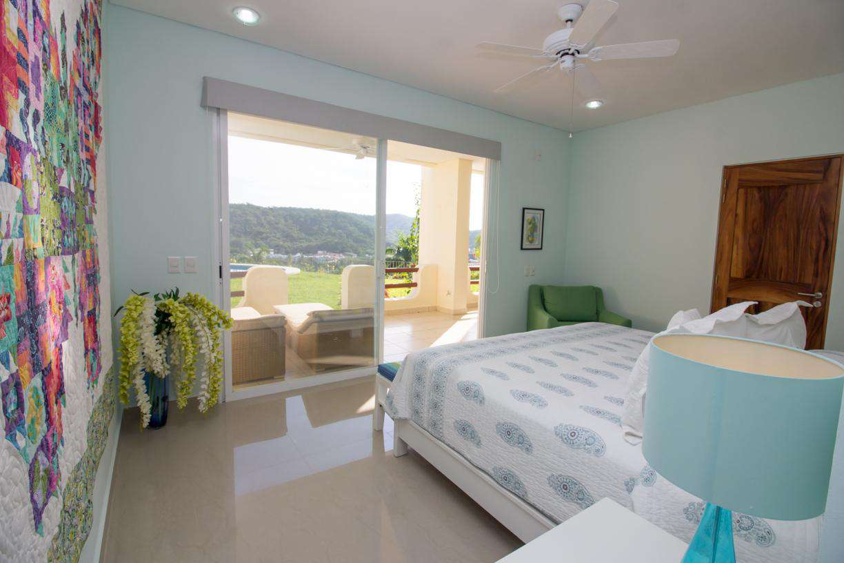 Master bedroom with king bed and step out to the loungers