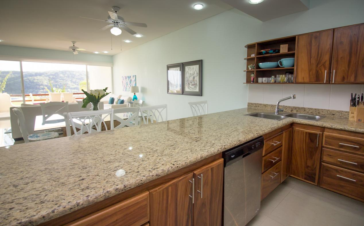 Granite countertops and stainless steel appliances in the fully equipped kitchen