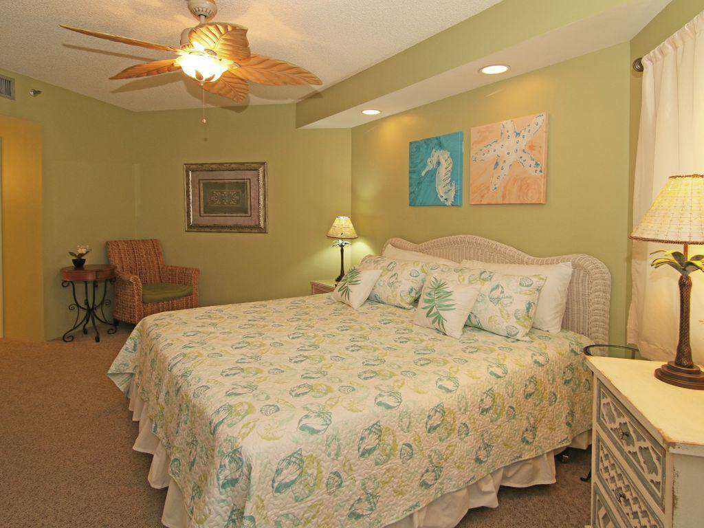 The master bedroom features an en-suite bathroom and king sized bed.