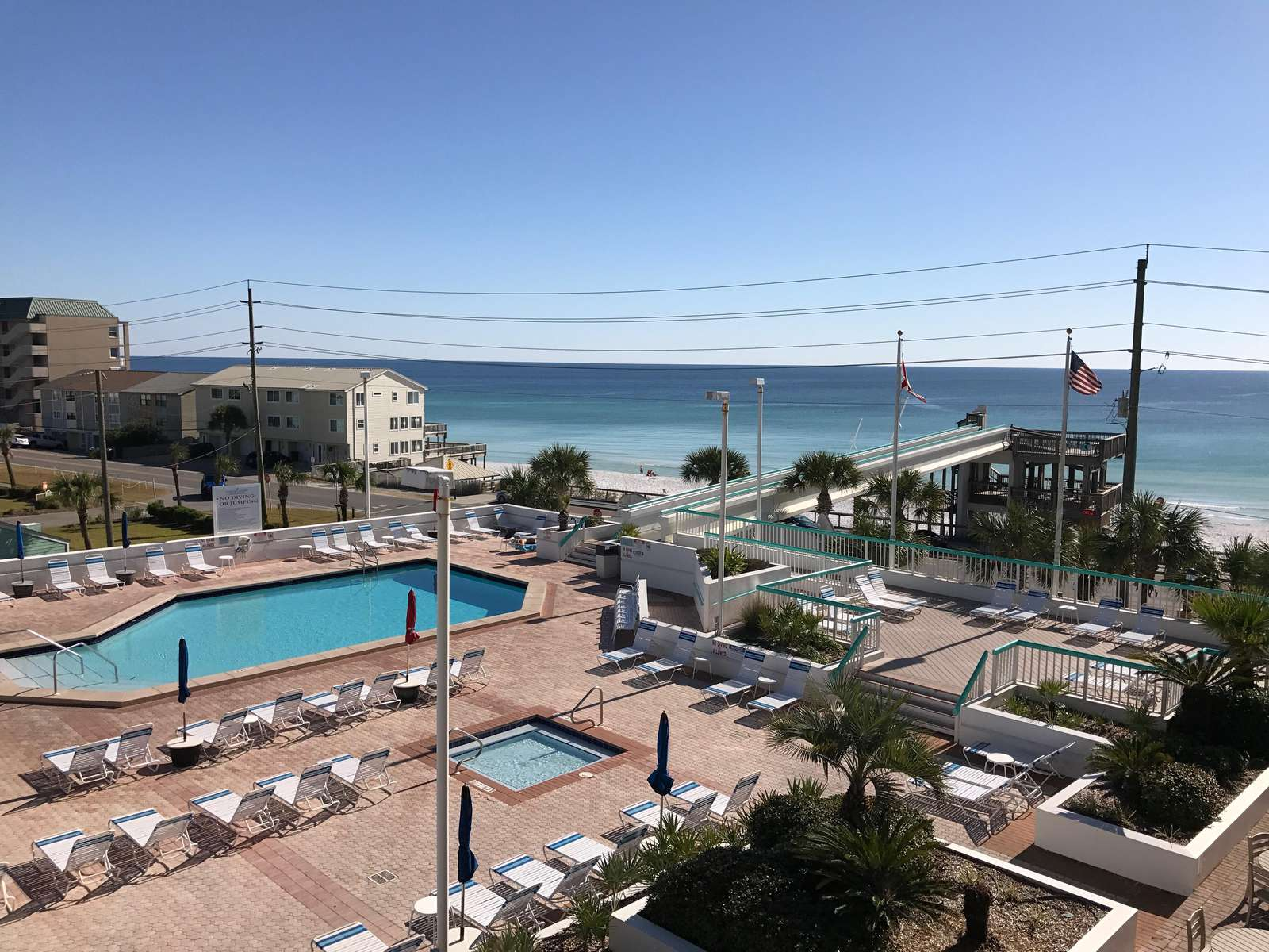 The pool deck features a large pool, 2 hot tubs, kiddie pool, tiki bar and beach road walkover.  There is also a beach bar on the walkover.