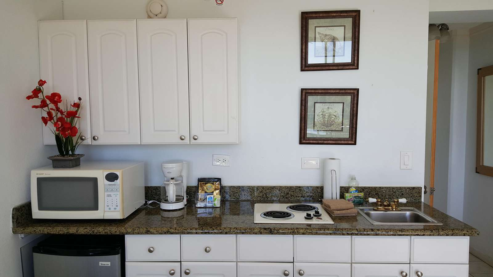 White, Clean & fully equipped Kitchenette