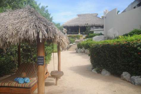 Exclusive day beds & view of restaurant from the beach