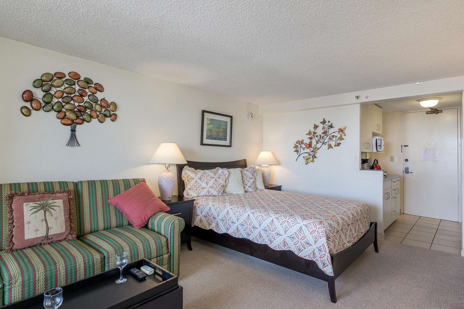 View of Queen Size Bed and Kitchenette