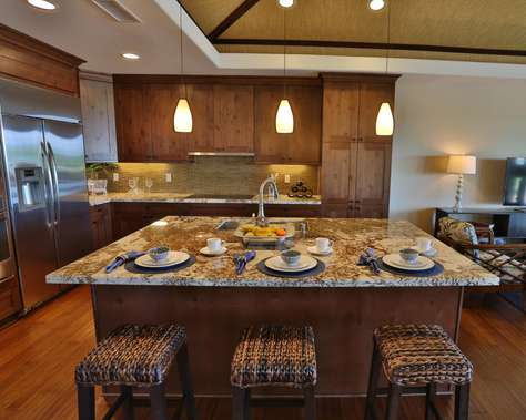 Island bar seating and gourmet kitchen