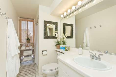 Bright and airy bathroom complete with Robes & Towels