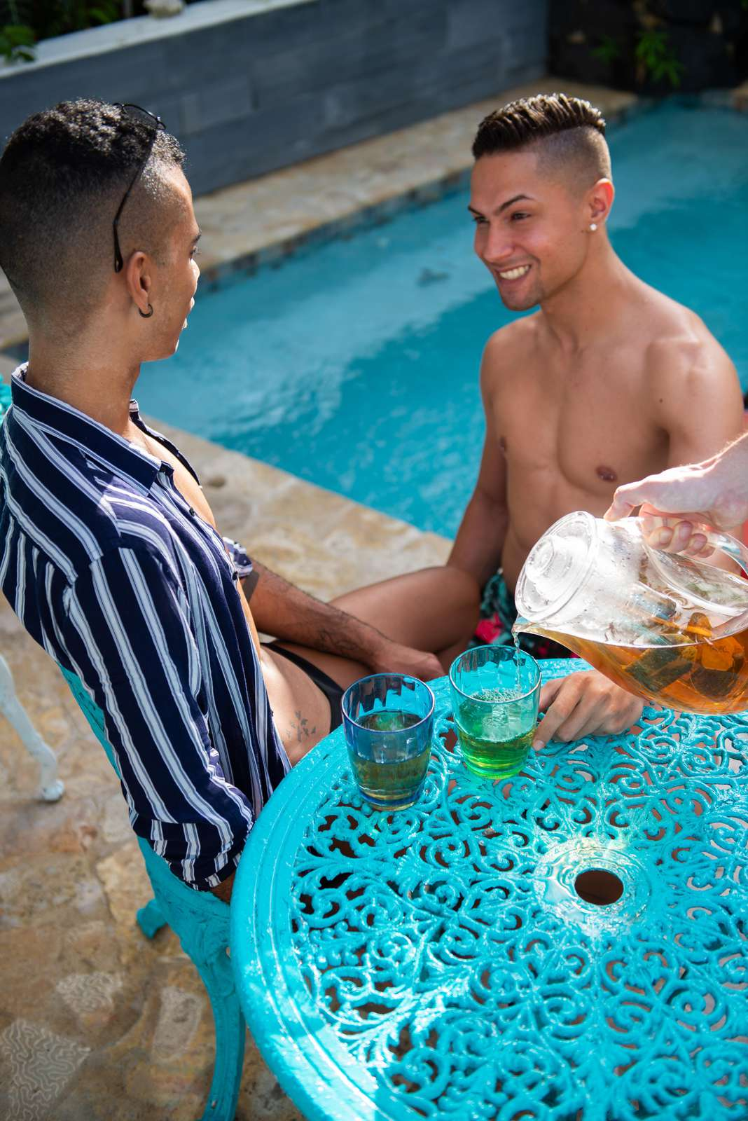 Enjoy coffee poolside at one of our two pools