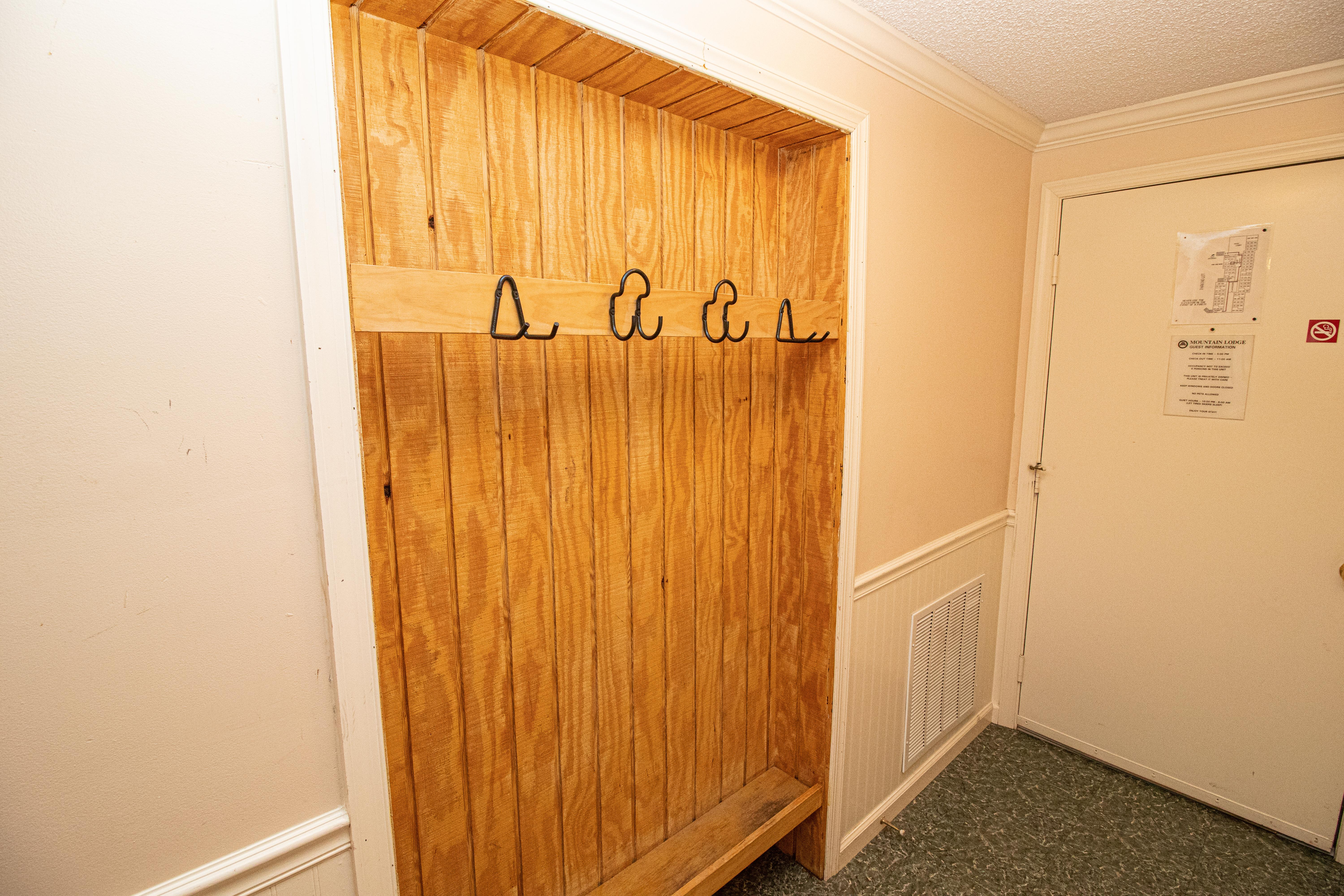 Recessed ski rack in hallway - store your gear securely inside the unit!