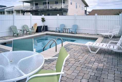 Private pool and deck area in fenced-in backyard