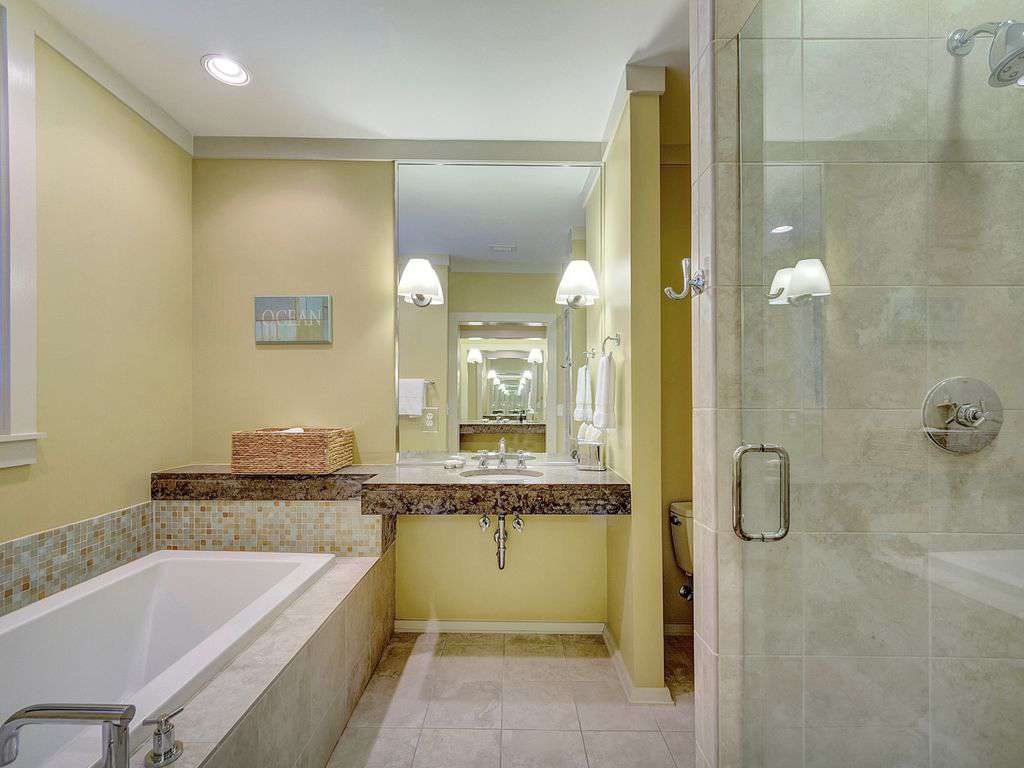 Master Bathroom Identical Sink at Opposite end Walk in Shower and Bath Tub