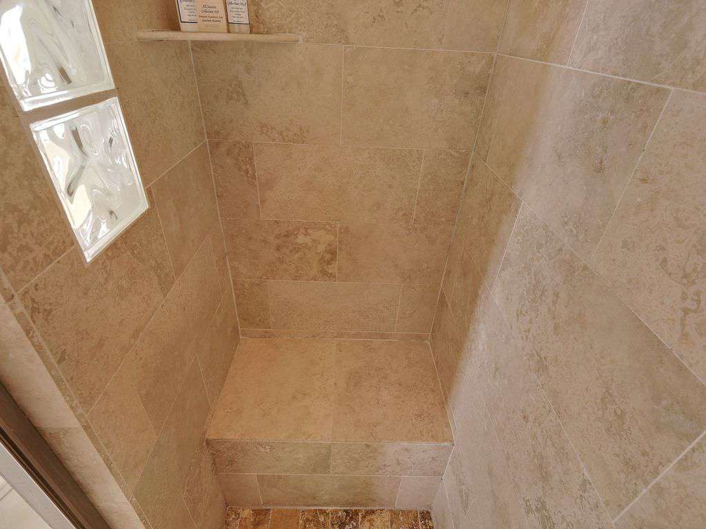 Spacious shower with seating