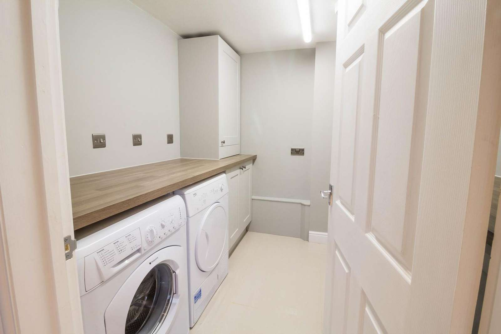 Great storage space in this utility room