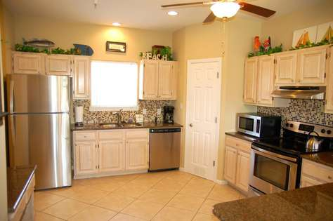 Spacious kitchen with stainless steel appliances.