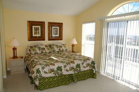 Third floor Master bedroom with access to a porch overlooking the Gulf.