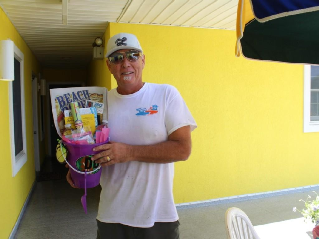 Our signature welcome baskets with Dewey Beach A Way of Life souvenir provided
