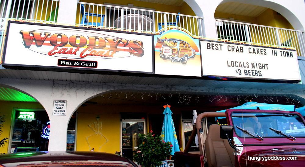 """Ground floor restaurant """"Woody's East Coast Bar & Grill"""" Famous for their one of kind crab cakes!"""