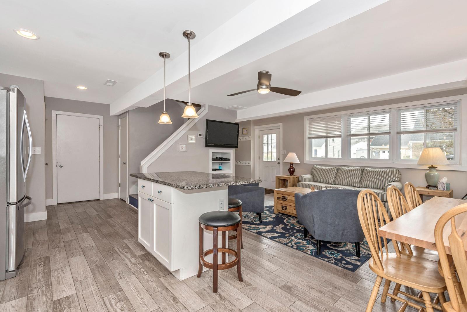 Garage, stairs, and half bath off of kitchen area