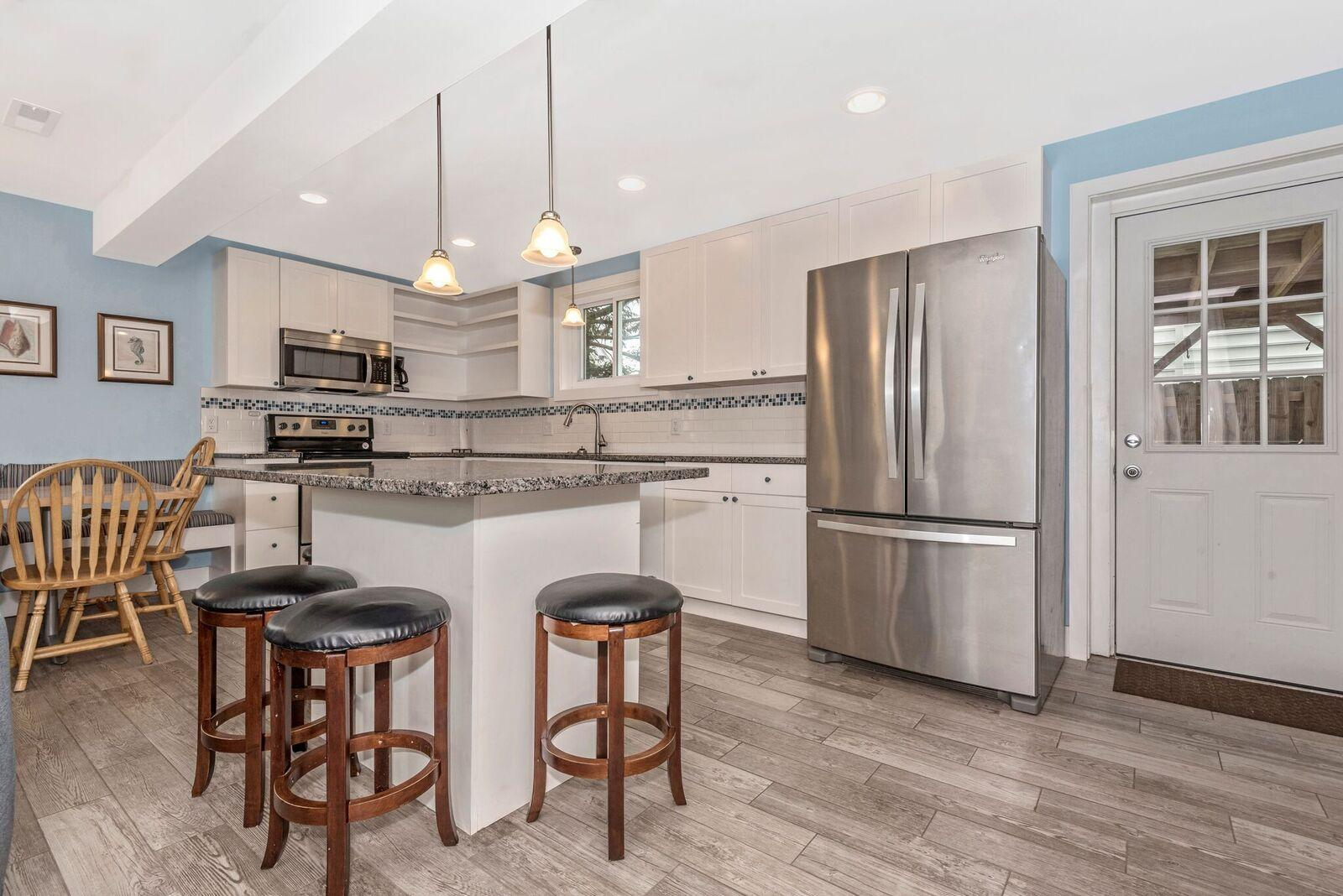 Kitchen island also has bar seating for extra dining