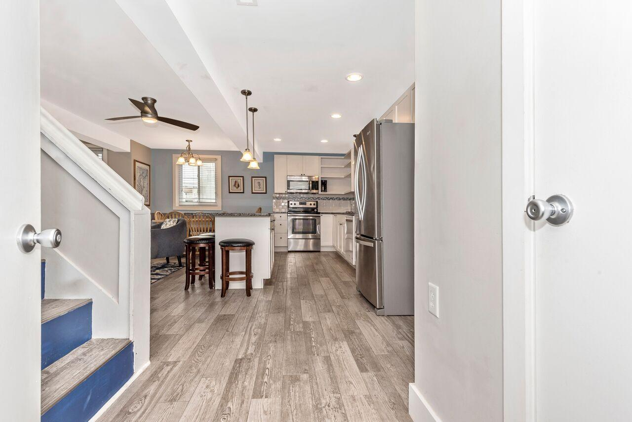 The garage with full washer and dryer is directly off first level kitchen