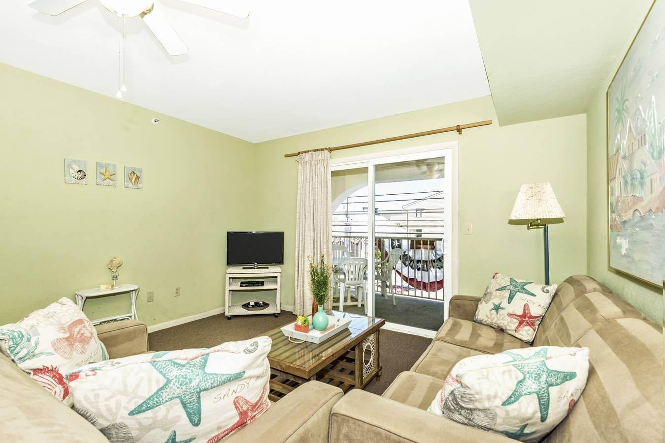 Living room with great views from the balcony, keep your finger on the pulse of Dewey!