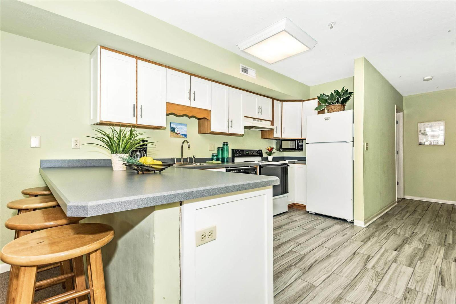 Spacious and clean kitchen with bar seating