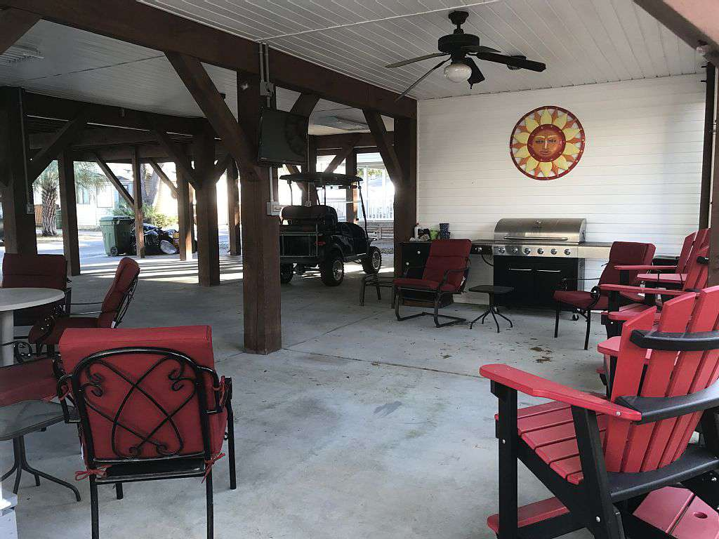 Great sitting area under the house for relaxing, grilling and a TV