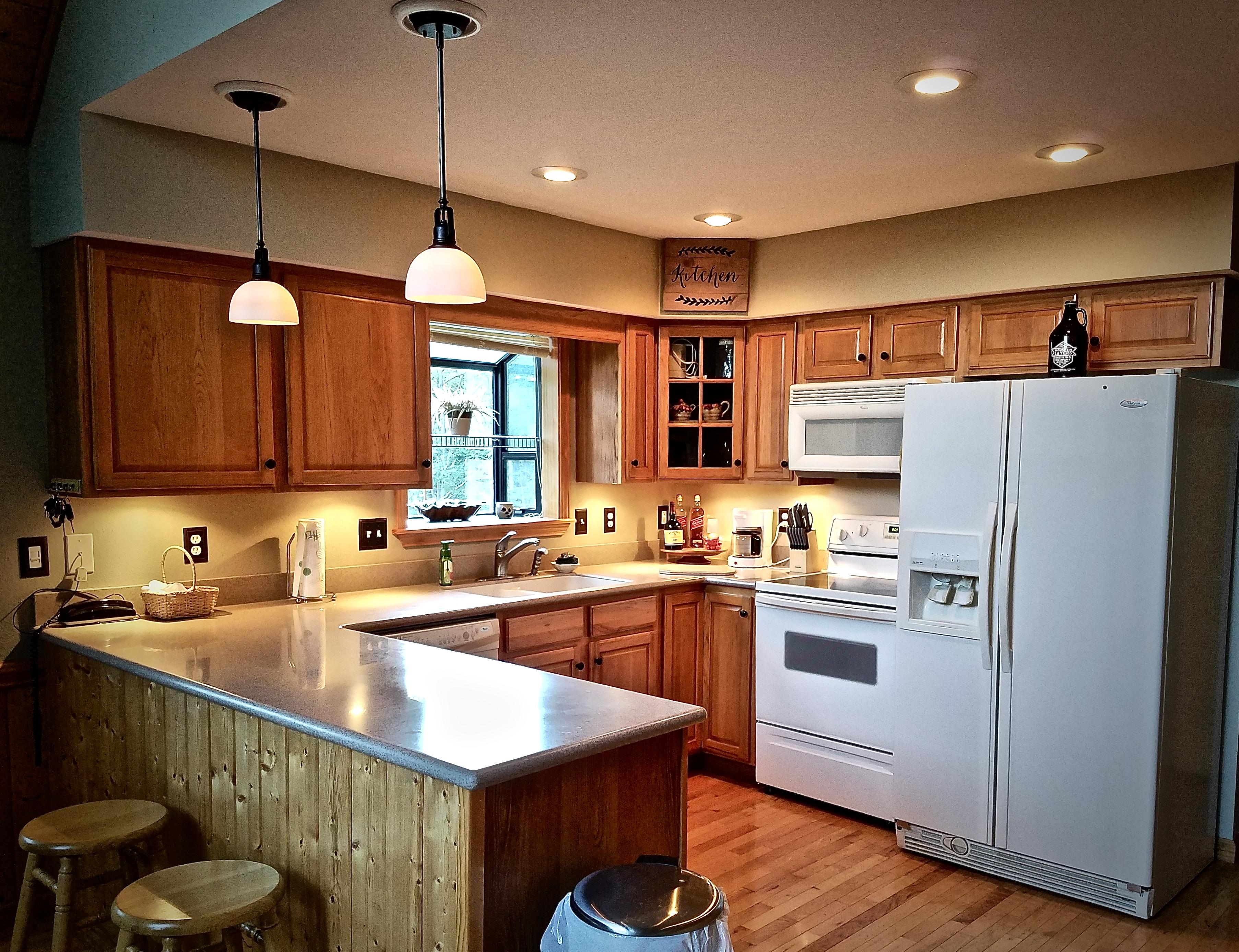 Solid surface Counter tops and a well appointed Kitchen