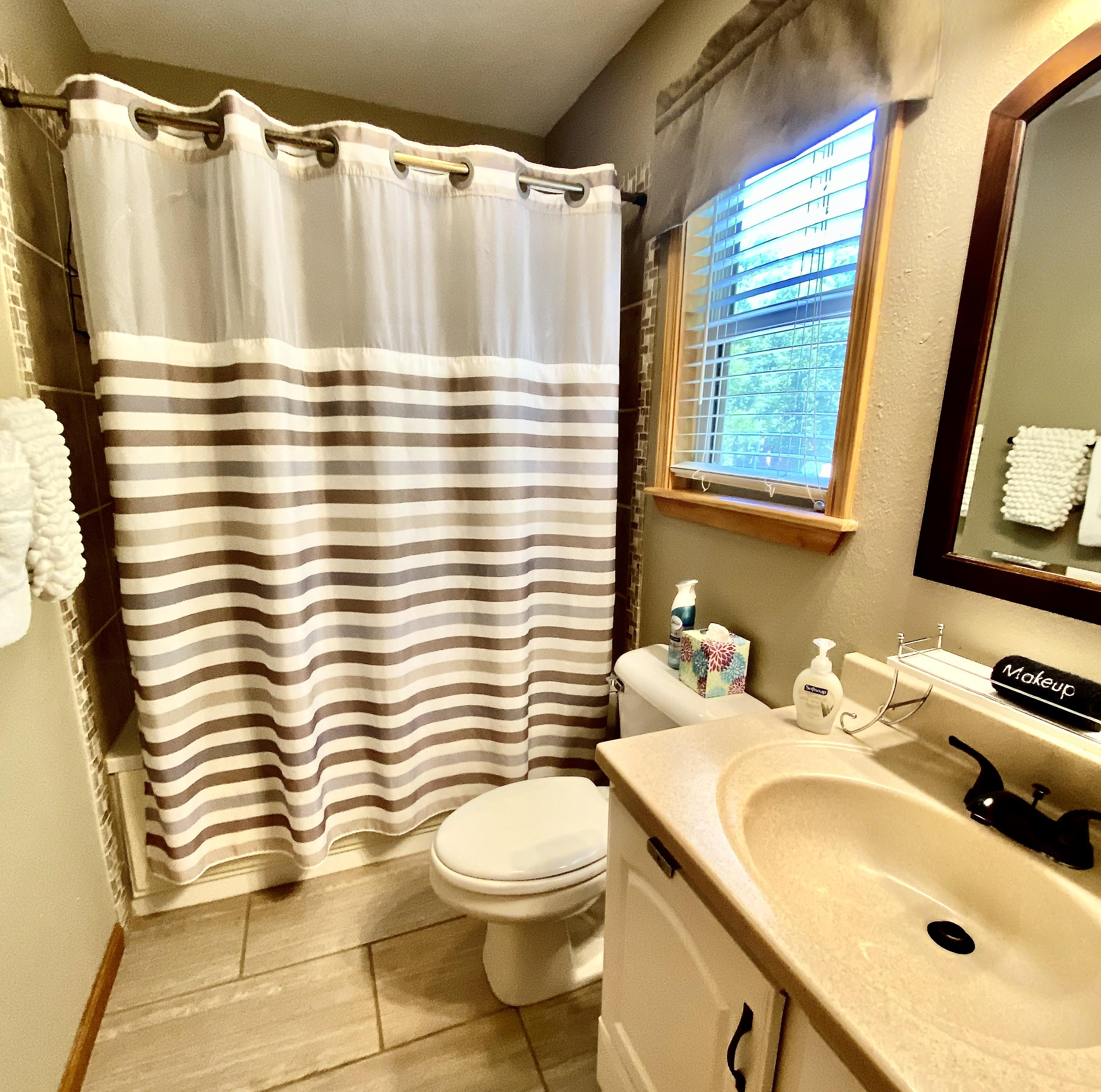 There is a full bathroom on each level of the cabin