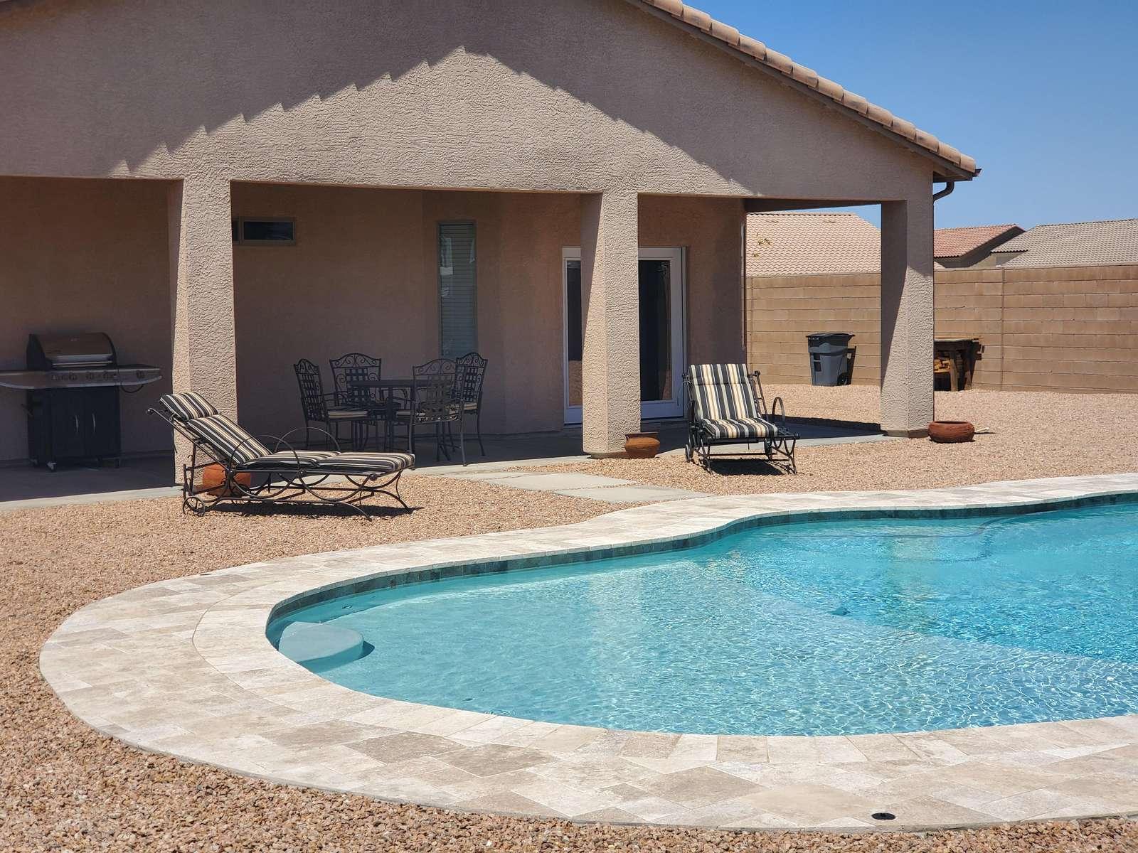 Pool with baja shelf entry.