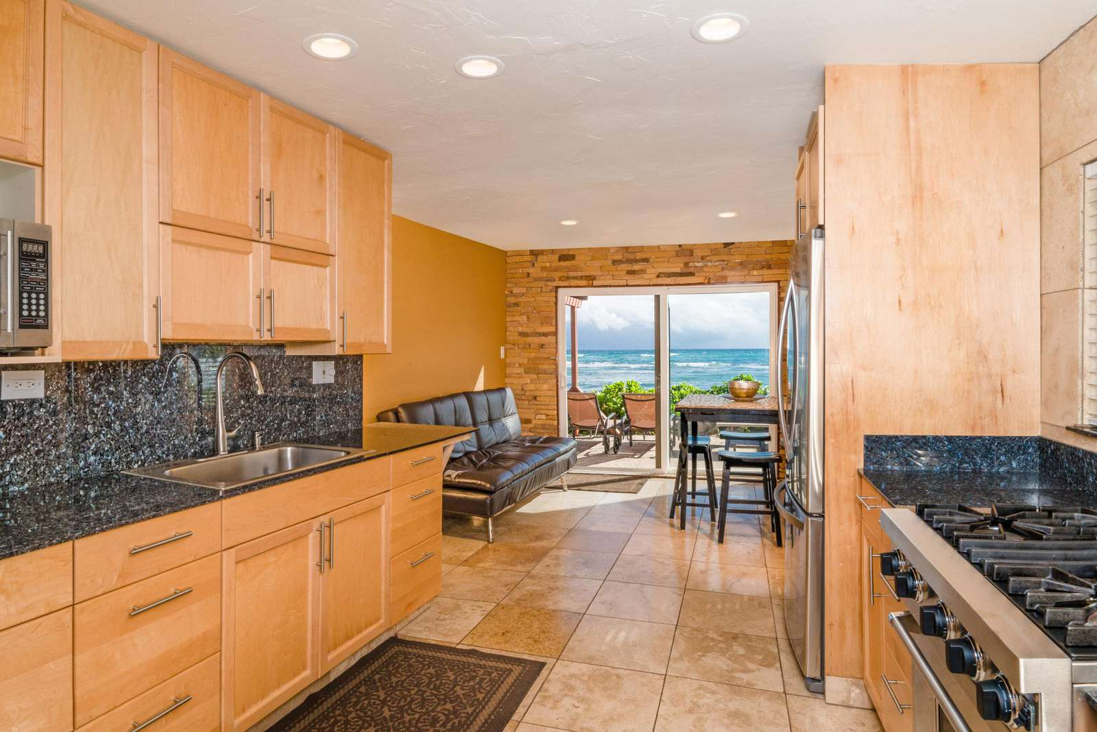 Large kitchen and dining area facing ocean. The beach is right outside of doors