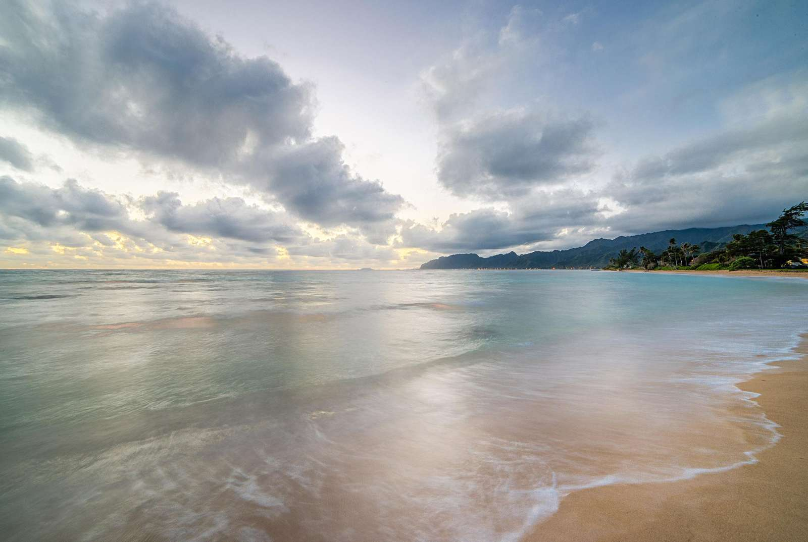 view of beachfront at dawn on calm morning