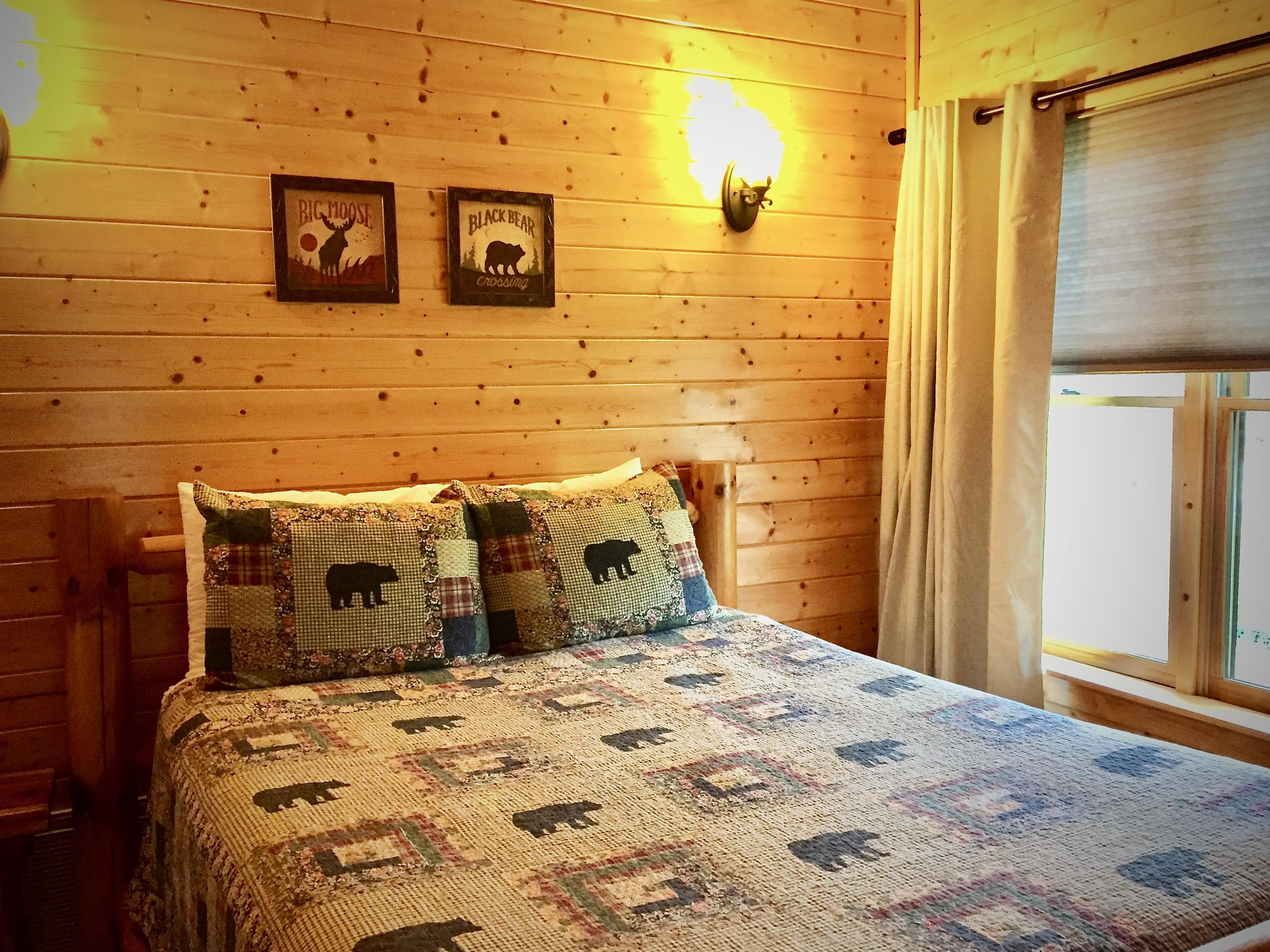 Second Master Queen suite upstairs offers Luxury Linens and Bear themed Decor