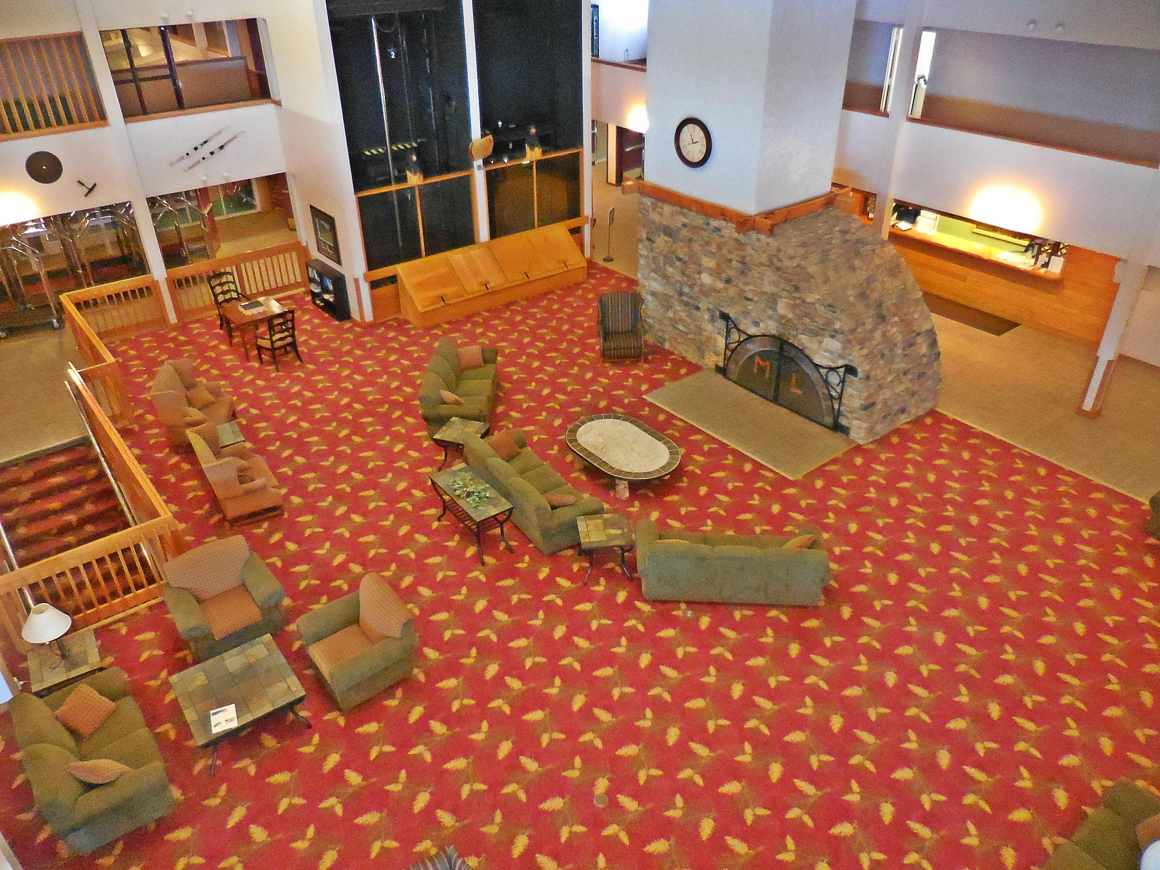 Sit by the large cozy fire in Mountain Lodge's main lobby