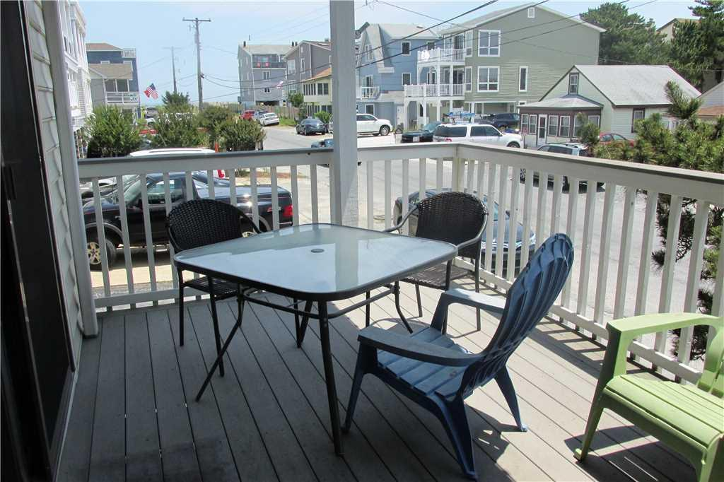 Main level balcony with outdoor dining table