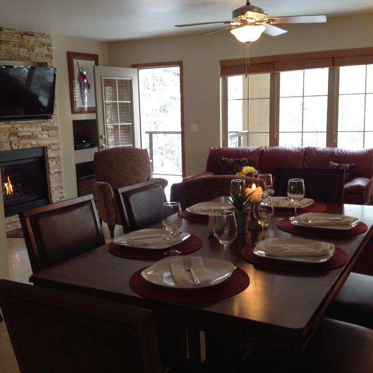 """Looking into living room with a gas fire place and 46"""" flat screen HD TV"""