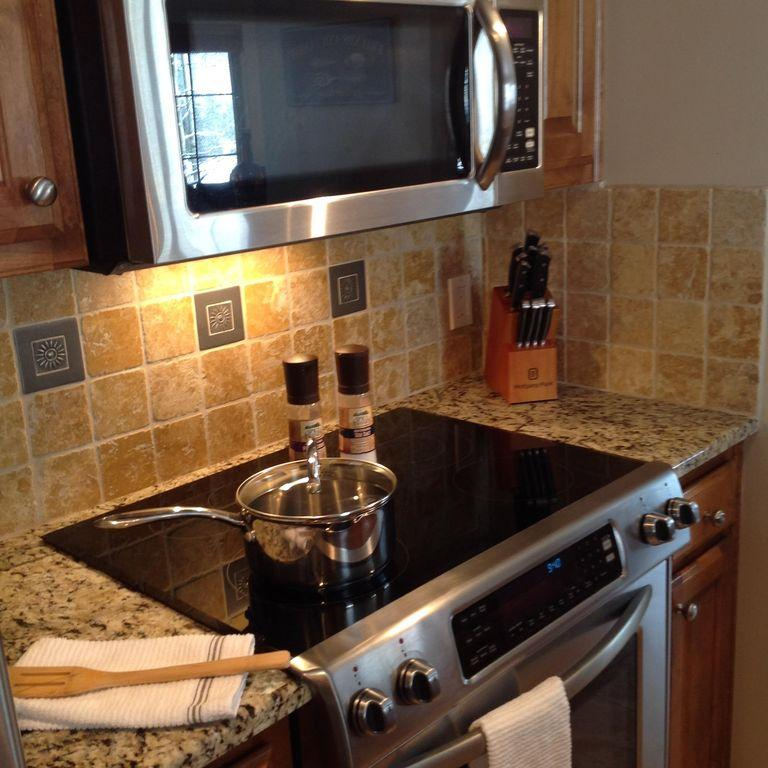 Kitchen high end stainless steel appliances, granite counter tops and fully stoc
