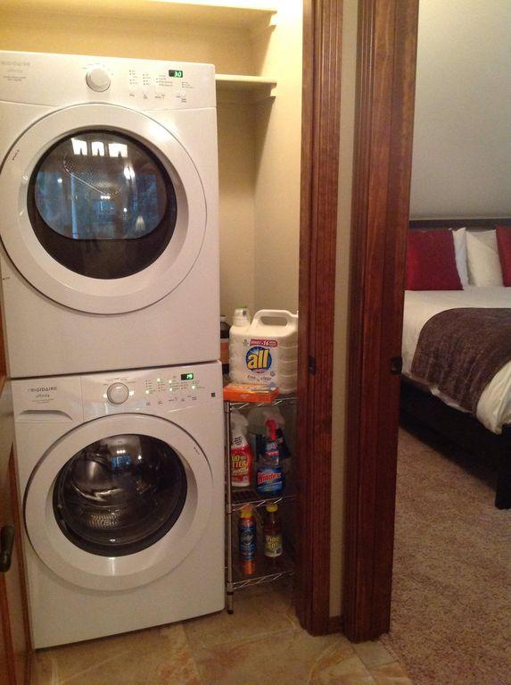 New washers and dryers with all laundry detergent and cleaning supplies
