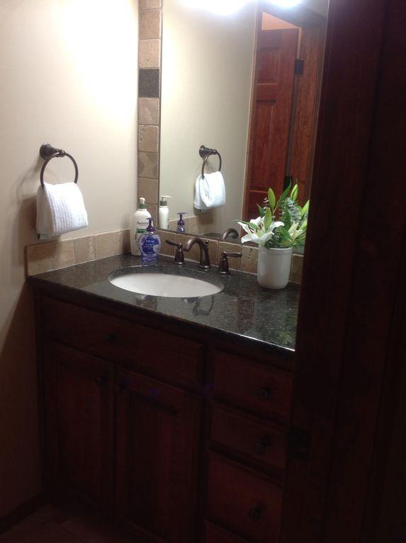 Vanity with big bottle lotion and a hotel size sham.& cond., hair dryer