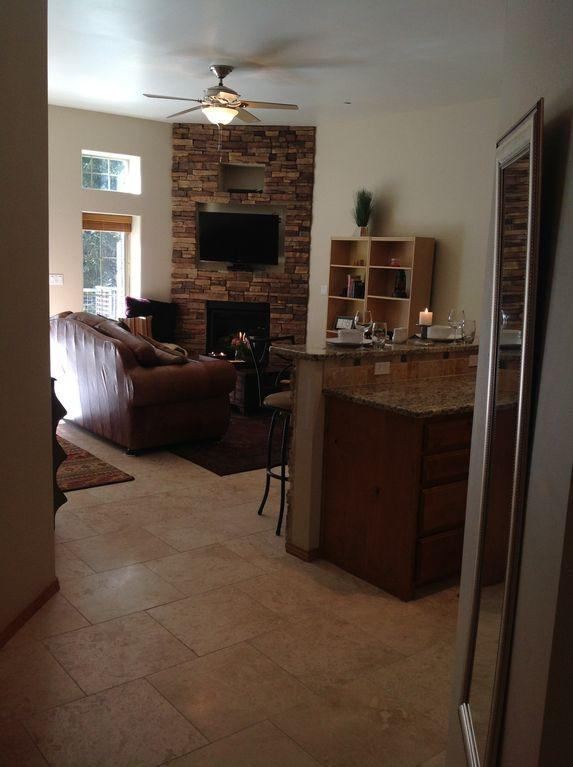Travertine tile floors, stone on fire and bar, new appliances, granite counters
