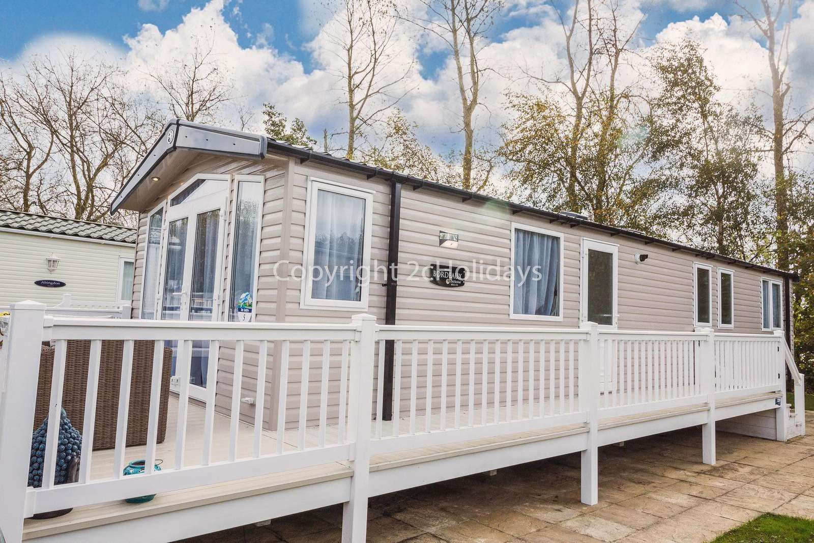8 berth accommodation with decking at Hopton Holiday Village
