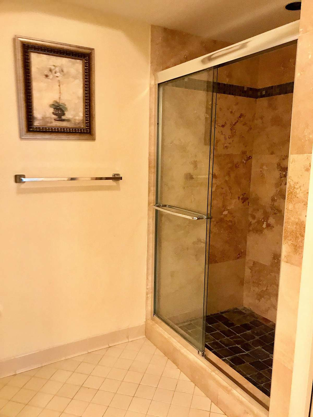 The master bath features a tiled shower.