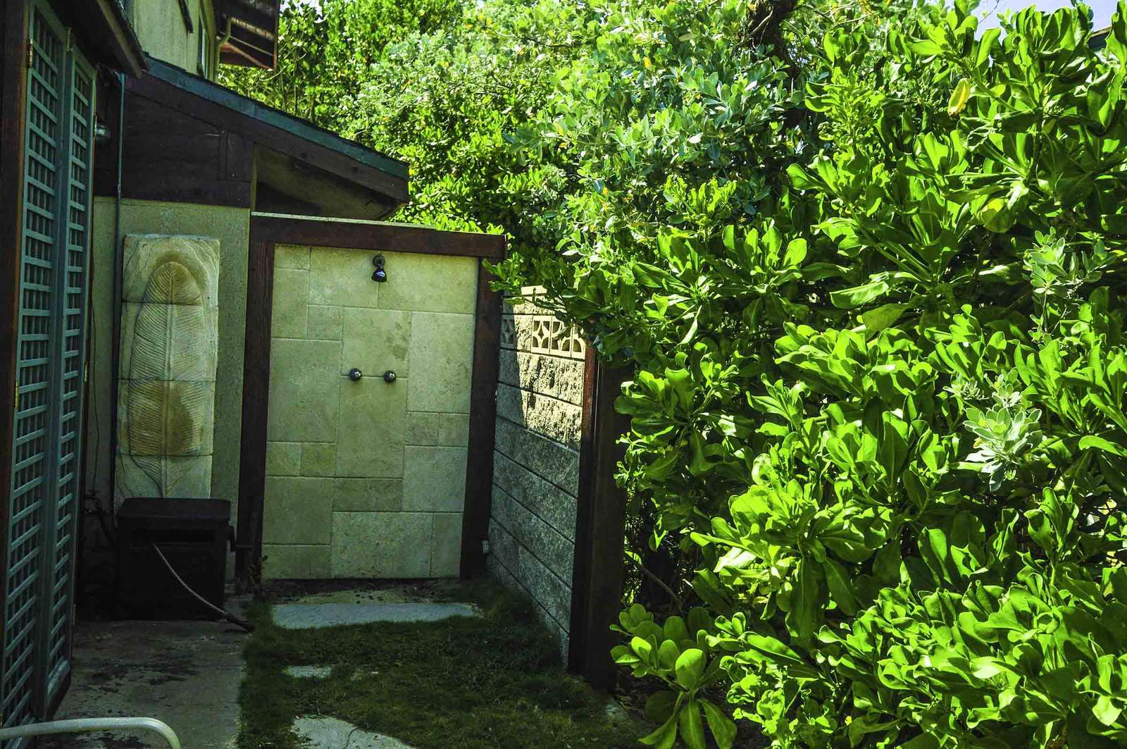 Additional private outdoor shower with hot & cold water.