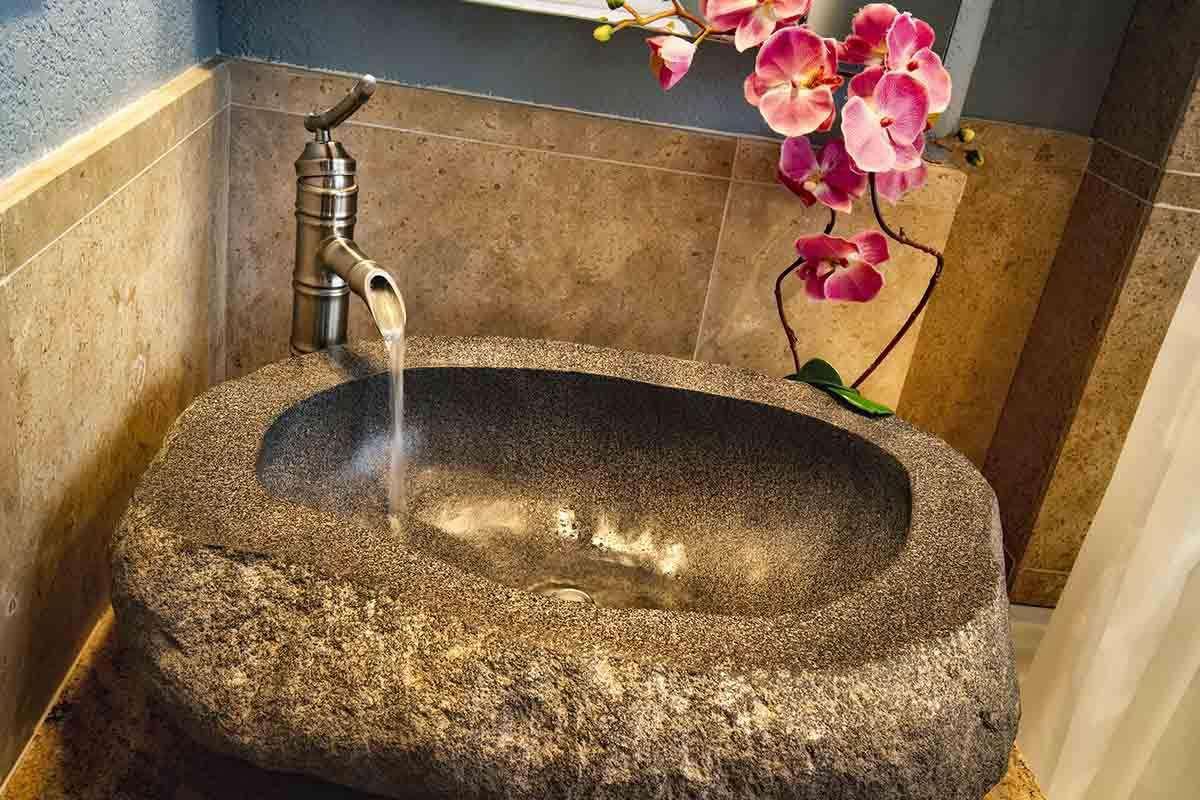 Detail of stone vanity sink in bedroom #2 bath area.