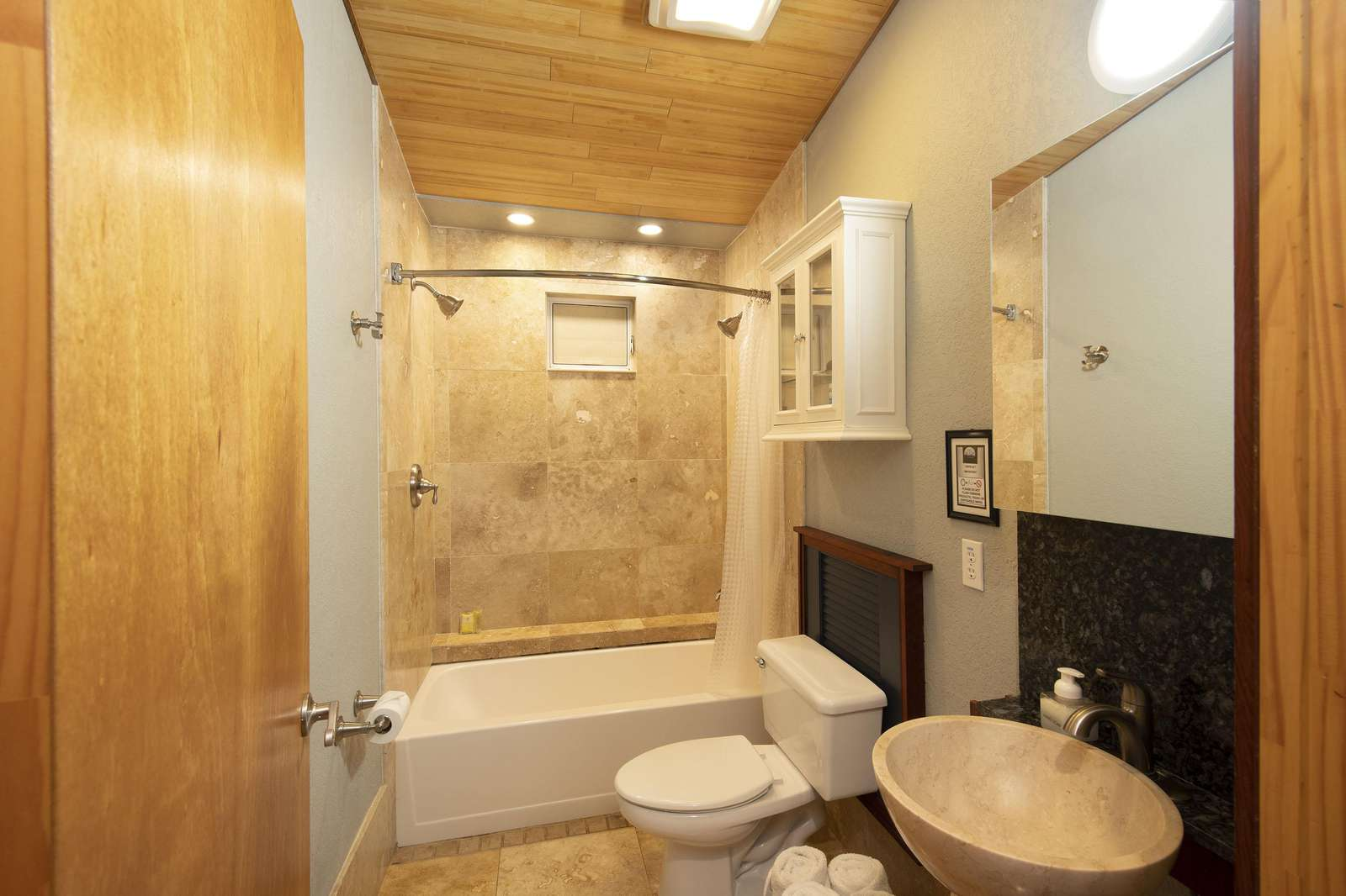 Bathroom tub with dual showerheads.